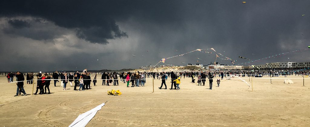 A photo of Berck sur Mer beach at the 2019 kite festival, just before a massive rain shower.