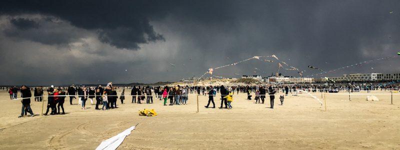 A photo of Berck sur Mer beach at the 2019 kite festival, just before a massive rain shower.
